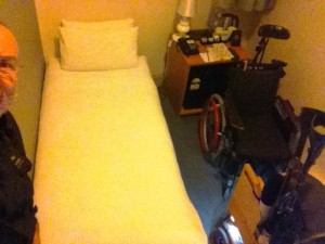 The tiniest room in the world: single bed, Bugger and The Chug, and only half of me.